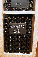 bottles in bins pommard 2002 chalk board domaine maillard chorey-les-beaune cote de beaune burgundy france
