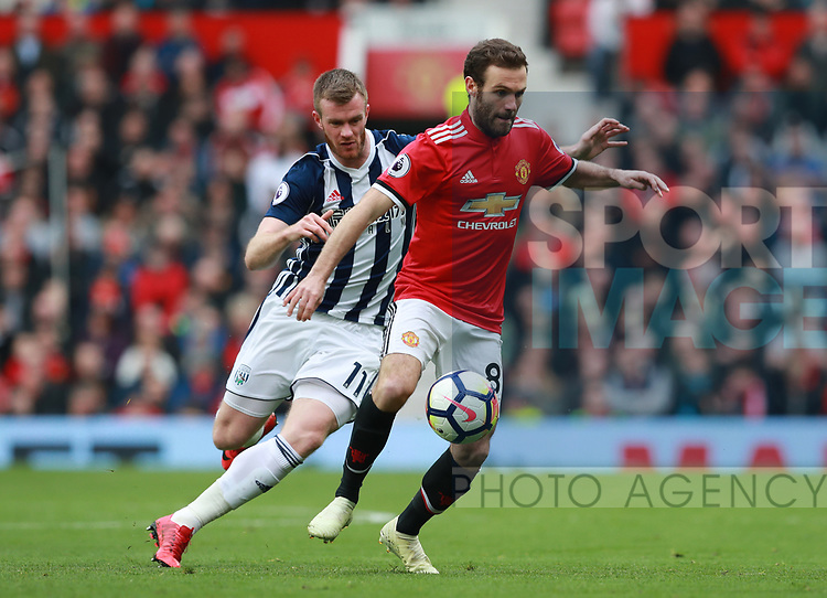 Chris Brunt of West Bromwich Albion tracks Juan Mata of Manchester United during the premier league match at the Old Trafford Stadium, Manchester. Picture date 15th April 2018. Picture credit should read: Simon Bellis/Sportimage