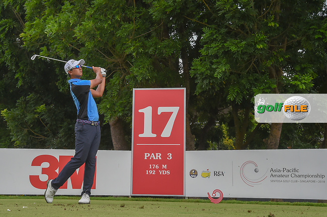Sadom KAEWKANJANA (THA) watches his tee shot on 17 during Rd 3 of the Asia-Pacific Amateur Championship, Sentosa Golf Club, Singapore. 10/6/2018.<br /> Picture: Golffile | Ken Murray<br /> <br /> <br /> All photo usage must carry mandatory copyright credit (© Golffile | Ken Murray)