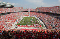 The Ohio State Buckeyes take the field prior to the NCAA football game against Buffalo at Ohio Stadium on Aug. 31, 2013. (Adam Cairns / The Columbus Dispatch)