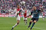 Nederland, Amsterdam, 25 maart 2012.Eredivisie .Seizoen 2011-2012.Ajax-PSV (2-0).Ricardo van Rhijn van Ajax en Erik Pieters van PSV strijden om de bal.