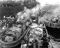 North Korean refugees use anything that will float to evacuate Hungnam.  Here they jam the decks of a South Korean LST and many fishing boats. December 19, 1950. (Navy)<br /> NARA FILE #:  080-G-424513<br /> WAR &amp; CONFLICT BOOK #:  1480