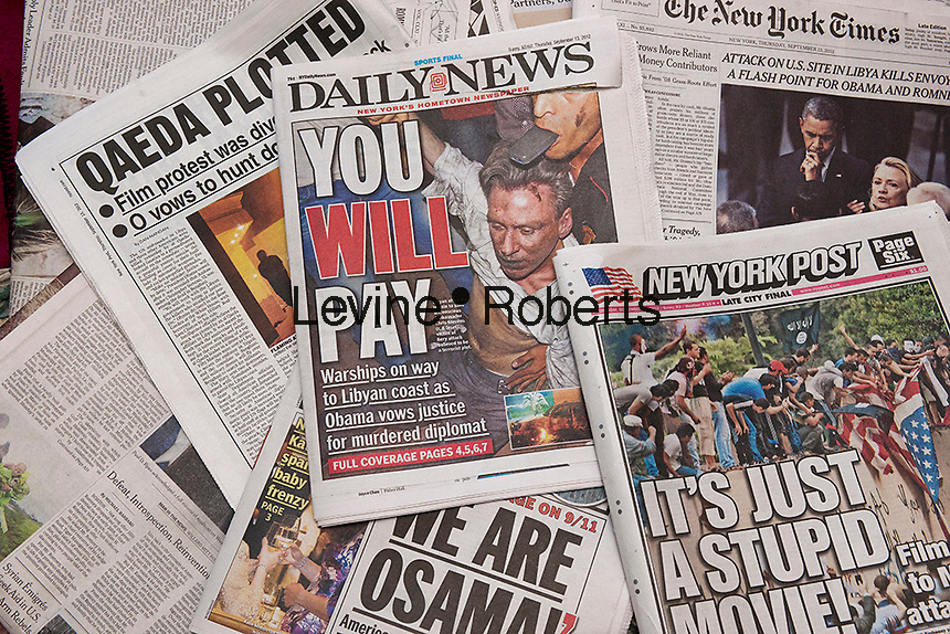 New York daily newspapers in September 2012 report on the rioting in the Middle East and the attacks on US embassies, resulting in several deaths including the US Ambassador Chris Stevens. The rioting was prompted by an amateurish film posted on YouTube which allegedly denigrated Islam and the Prophet Muhammad. (© Richard B. Levine)