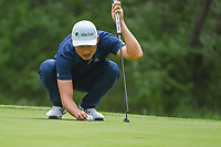 HaoTong Li (CHN) looks over his putt on 1 during day 1 of the Valero Texas Open, at the TPC San Antonio Oaks Course, San Antonio, Texas, USA. 4/4/2019.<br /> Picture: Golffile | Ken Murray<br /> <br /> <br /> All photo usage must carry mandatory copyright credit (© Golffile | Ken Murray)