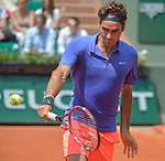Roger Federer (SUI) defeats Marcel Granollers (ESP) 6-2, 7-6, 6-3 at  Roland Garros being played at Stade Roland Garros in Paris, France on May 27, 2015