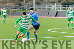 On the Run<br /> ----------------<br /> Wayne Sparling, Killarney Celtic gets away from Michael Greaney, Dingle Bay Rovers, when the sides met at Mounthawk pk, Tralee in the Final of the Munster Junior Cup which Celtic came out on top with a 2-0 victory.