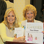 Fan Joan Ackerman poses with Guiding Light's Tina Sloan with her new book Changing Shoes appears at Barnes & Noble on September 30, 2010 at Smith Haven Mall in Lake Grove, New York store for a reading, talk and book signing. (Photo by Sue Coflin/Max Photos