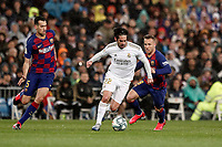 1st March 2020; Estadio Santiago Bernabeu, Madrid, Spain; La Liga Football, Real Madrid versus Club de Futbol Barcelona; Francisco Alarcon, ISCO (Real Madrid) breaks away from Sergio Busquets of Madrid