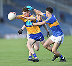 John Murphy of  Clare  in action against Mark O Meara of  Tipperary during their Munster Minor football semi-final at Thurles. Photograph by John Kelly.
