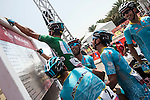 Andrea Guardini (ITA) wearing the Green Jersey signs on with some help from his Astana Team mates before the start of Stage 3, The Al Ain Stage, of the 2015 Abu Dhabi Tour starting from the Al Qattara Souq in Al Ain and running 142 km to the mountain top finish at Jebel Hafeet at 1025 metres, Abu Dhabi. 10th October 2015.<br /> Picture: ANSA/Claudio Peri | Newsfile