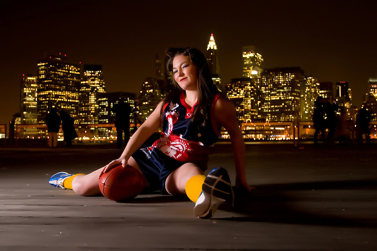 NEW YORK - FEBRUARY 7:  Christina Licata of Team Freedom, the Official Womens American League of the Austrialian League Footy Team, poses on underneath The Brooklyn Bridge February 7, 2009 in New York City. (Photo by Donald Bowers)