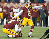 Washington Redskins place kicker Kai Forbath (2) kicks the game-winning field goal against the Philadelphia Eagles at FedEx Field in Landover, Maryland on Saturday, December 20, 2014.  The Redskins won the game 27 - 24.<br /> Credit: Ron Sachs / CNP