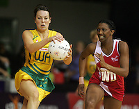 16.11.2007 Australian Laura von Bertouch and England's Amanda Newton in action during the Australia v England match at the New World Netball World Champs held at Trusts Stadium Auckland New Zealand. Mandatory Photo Credit ©Michael Bradley.