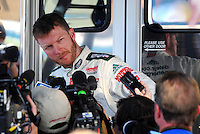 Nov. 7, 2008; Avondale, AZ, USA; NASCAR Sprint Cup Series driver Dale Earnhardt Jr is interviewed by the media following practice for the Checker Auto Parts 500 at Phoenix International Raceway. Mandatory Credit: Mark J. Rebilas-