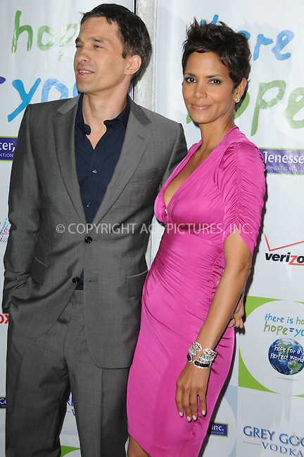 WWW.ACEPIXS.COM . . . . . ....April 17 2011, Los Angeles....Actors Olivier Martinez (L) and Halle Berry arriving at the 2011 Jenesse Silver Rose Auction and Gala at the Beverly Hills Hotel on April 17, 2011 in Beverly Hills, CA....Please byline: PETER WEST - ACEPIXS.COM....Ace Pictures, Inc:  ..(212) 243-8787 or (646) 679 0430..e-mail: picturedesk@acepixs.com..web: http://www.acepixs.com