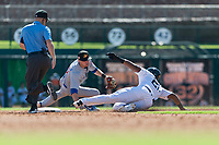 Glendale Desert Dogs first baseman Steven Sensley (21), of the New York Yankees organization, slides into second base around the tag attempt by Nico Hoerner (17) as field umpire Brennan Miller looks on during an Arizona Fall League game against the Mesa Solar Sox at Camelback Ranch on October 15, 2018 in Glendale, Arizona. Mesa defeated Glendale 8-0. (Zachary Lucy/Four Seam Images)