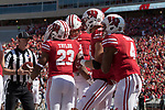 Wisconsin Badgers running back Jonathan Tayler (23) celebrates a touchdown with teammates during an NCAA College Football game against the Florida Atlantic Owls Saturday, September 9, 2017, in Madison, Wis. The Badgers won 31-14. (Photo by David Stluka)