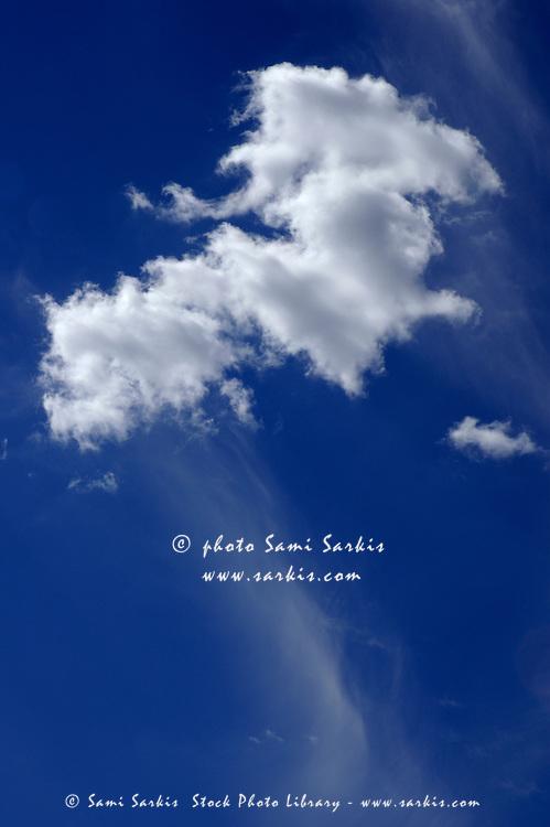 Clouds in a beautiful blue, sunny sky.