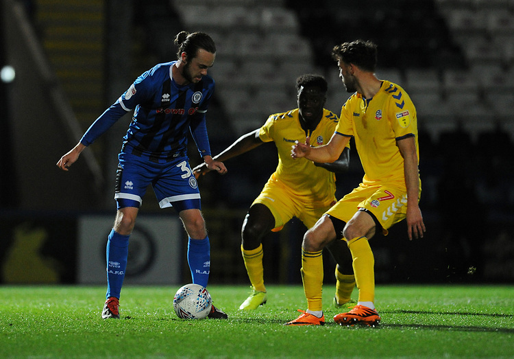 Rochdale's Matt Gillam under pressure from Bolton Wanderers' Josh Emmanuel and Will Buckley<br /> <br /> Photographer Kevin Barnes/CameraSport<br /> <br /> EFL Leasing.com Trophy - Northern Section - Group F - Rochdale v Bolton Wanderers - Tuesday 1st October 2019  - University of Bolton Stadium - Bolton<br />  <br /> World Copyright © 2018 CameraSport. All rights reserved. 43 Linden Ave. Countesthorpe. Leicester. England. LE8 5PG - Tel: +44 (0) 116 277 4147 - admin@camerasport.com - www.camerasport.com
