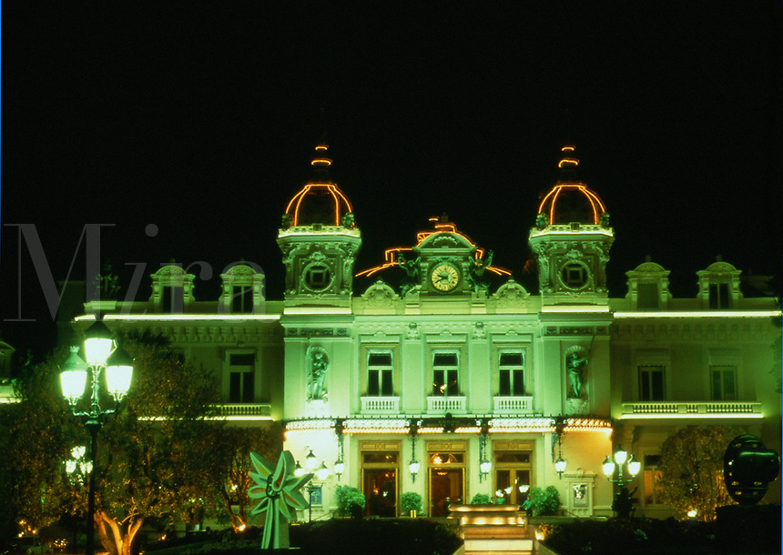 The ornate exterior of an Monte Carlo casino lit up at night. Monaco.