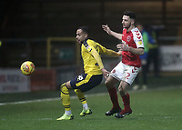 Oxford United's Jordan Graham shields the ball from  Fleetwood Town's Lewis Coyle<br /> <br /> Photographer Rich Linley/CameraSport<br /> <br /> The EFL Sky Bet League One - Fleetwood Town v Oxford United - Saturday 12th January 2019 - Highbury Stadium - Fleetwood<br /> <br /> World Copyright &copy; 2019 CameraSport. All rights reserved. 43 Linden Ave. Countesthorpe. Leicester. England. LE8 5PG - Tel: +44 (0) 116 277 4147 - admin@camerasport.com - www.camerasport.com