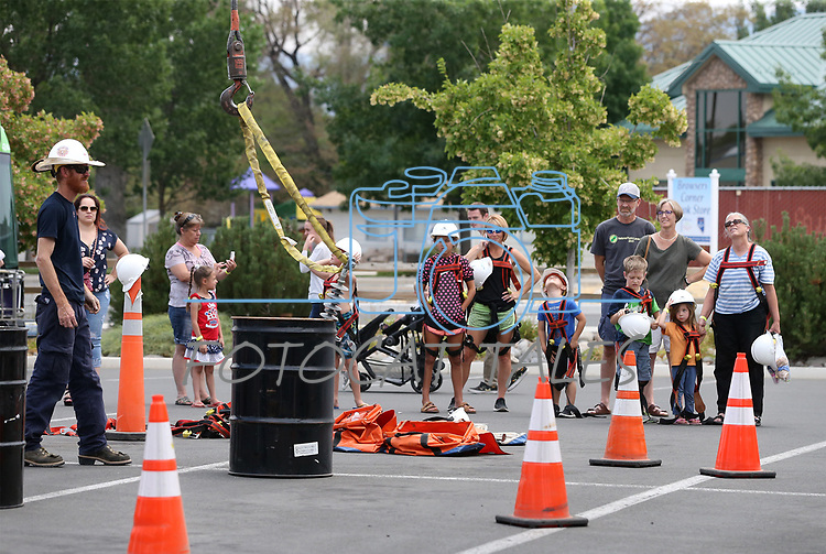 Residents enjoy the Touch-a-Truck event at the Carson City Library in Carson City, Nev., on Saturday, Aug. 5, 2017. <br /> Photo by Cathleen Allison/Nevada Photo Source