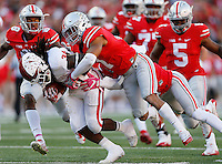 Ohio State Buckeyes cornerback Damon Webb (7) and cornerback Gareon Conley (8) bring down Indiana Hoosiers running back Devine Redding (34) during the third quarter of the NCAA football game at Ohio Stadium in Columbus on Oct. 8, 2016. (Adam Cairns / The Columbus Dispatch)