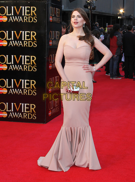 Hayley Atwell.The Olivier Awards held at the Royal Opera House, Covent Garden, London, England..April 15th 2012.full length pink beige strapless fishtail dress hand on hip clutch bag silver .CAP/ROS.©Steve Ross/Capital Pictures