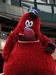 Aces mascot Archie sticks out his tongue at the camera.  Tom Smedes photo.