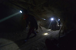 Miners inside a mine in Potosi, Bolivia. The mine produces silver and other metals.