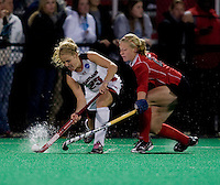 Harriet Tibble (23) of Maryland passes the ball away from Danica Deckard (23) of Ohio State during the NCAA Field Hockey Championship semfinals in College Park, MD.  Maryland defeated Ohio State, 3-1.