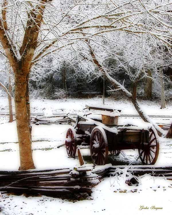 A wagon rests in the snow. Ortonized for a dreamlike appearance.