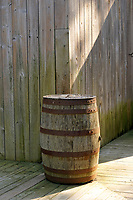 Wooden rainwater barrel at The Lachine Museum or Musee de Lachne in the Maison Ber-Le Moyne, Montreal, Quebec, Canada