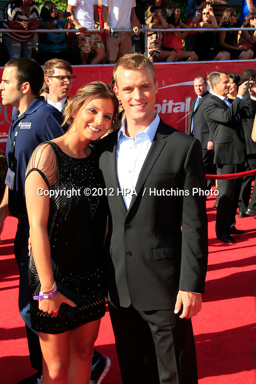 LOS ANGELES - JUL 11:  Maya Gabeira, Jesse Spencer arrives at the 2012 ESPY Awards at Nokia Theater at LA Live on July 11, 2012 in Los Angeles, CA