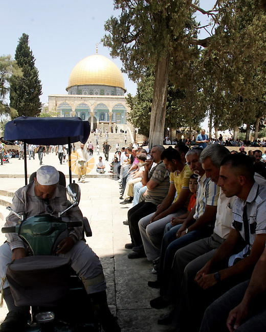 Palestinian Muslims attend Friday prayers in the Al Aqsa Mosque compound, also known to Jews as the Temple Mount, in Jerusalem's old city on July 9, 2010. Israel's recent announcement of the four Hamas members of the Palestinian Legislative Council were stripped of their residency rights and given a deadline to leave the city. Photo by Mahfouz Abu Turk