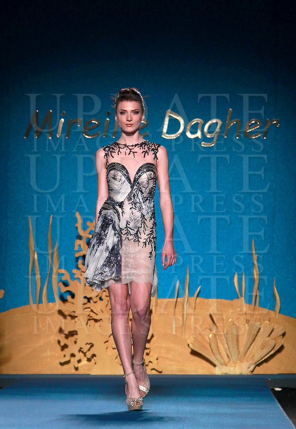 Una modella veste una creazione della collezione Primavera Estate 2014 di Mireille Dagher durante la rassegna Altaroma, a Roma, 26 gennaio 2014.<br /> A model wears a creation by Mireille Dagher's 2014 Spring Summer collection at the Altaroma fashion week in Rome, 26 January 2014.<br /> UPDATE IMAGES PRESS/Isabella Bonotto
