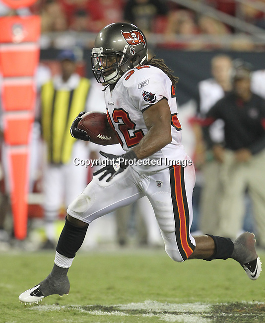 Tampa Bay Buccaneer running back Clifton Smith breaks loose for a first down in the first quarter. The Buccaneers defeated the Chiefs 20-15 during an NFL preseason game Saturday, Aug. 21, 2010 in Tampa,Fla. (AP Photo/Margaret Bowles).