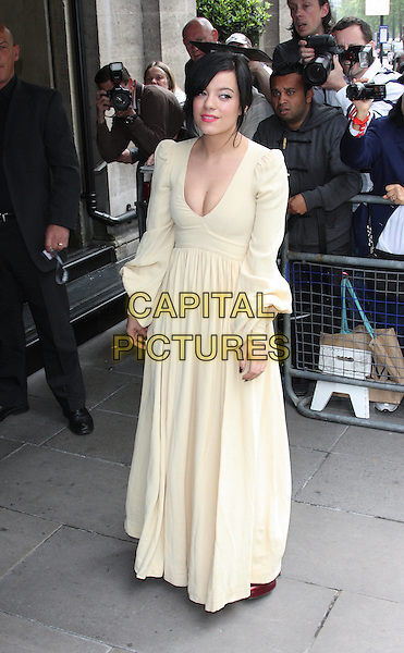 LILY ALLEN.The Ivor Novello Awards at the Grosvenor House Hotel, Park Lane, London, England..May 20th 2010.full length white dress yellow cream v-neck low cut neckline cleavage long sleeves red shoes maxi .CAP/ROS.©Steve Ross/Capital Pictures