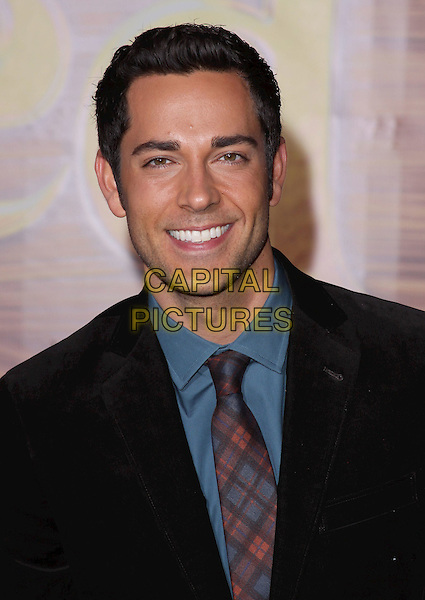 "ZACHARY LEVI .""Tangled"" Los Angeles Premiere held at the El Capitan Theatre, Hollywood, California, USA, 14th November 2010..portrait headshot  black suit shirt blue tartan red plaid tie teal smiling .CAP/ADM/CH.©Charles Harris/AdMedia/Capital Pictures"