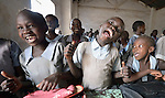 Girl students sing in class at the John Paul II School in Wau, South Sudan.