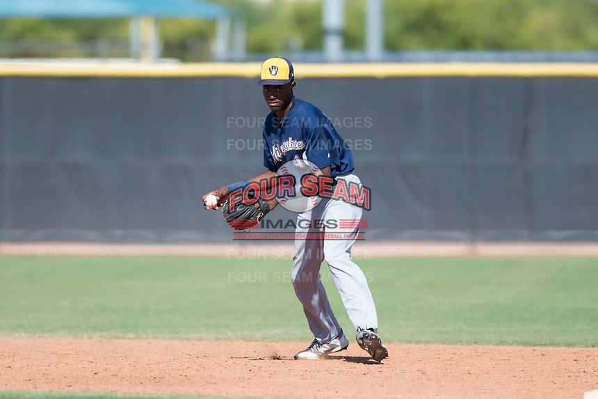 Milwaukee Brewers shortstop Korry Howell (40) prepares to make a throw to first base during an Instructional League game against the San Diego Padres at Peoria Sports Complex on September 21, 2018 in Peoria, Arizona. (Zachary Lucy/Four Seam Images)