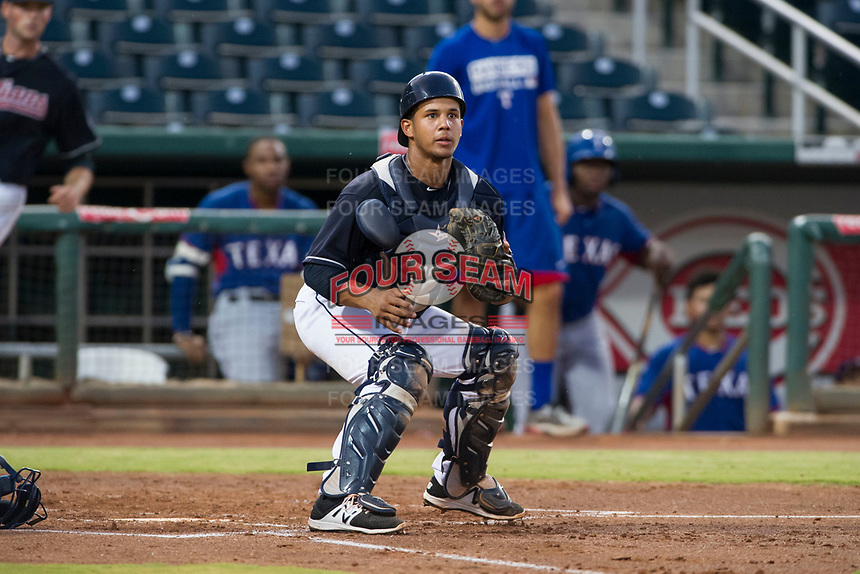 AZL Indians catcher Angel Lopez Alvarez (12) on defense against the AZL Rangers on August 26, 2017 at Goodyear Ball Park in Goodyear, Arizona. AZL Indians defeated the AZL Rangers 5-3. (Zachary Lucy/Four Seam Images)