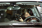 Videographer shooting interior details of the 2007 MINI Cooper at the North American International Auto Show, 2007