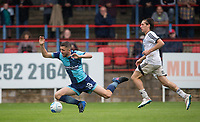 James Rowe of Aldershot Town brings down Danny Rowe of Wycombe Wanderers for a penalty during the pre season friendly match between Aldershot Town and Wycombe Wanderers at the EBB Stadium, Aldershot, England on 22 July 2017. Photo by Andy Rowland.