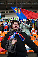Moscow, Russia, 23/02/2003..Women sing and dance during a rally at Luzhniki sports stadium supporting Prime Minister Vladimir Putin's presidential election campaign.