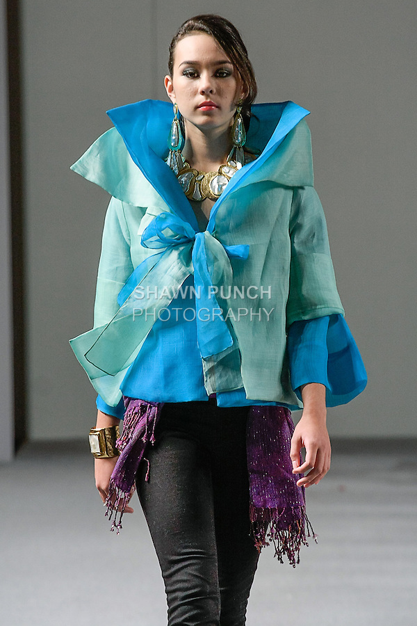 Model walks runway in an outfit from the Barge Ramos collection, during Couture Fashion Week Spring 2013 in NYC, on September 16, 2012.