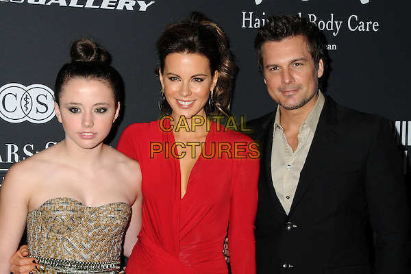 Lily Mo Sheen, Kate Beckinsale, Len Wiseman<br /> The Pink Party 2013 held at the Santa Monica Airport, Santa Monica, California, USA.<br /> October 19th, 2013<br /> half length dress red strapless yellow stubble facial hair beige black suit married husband wife <br /> CAP/ADM/BP<br /> &copy;Byron Purvis/AdMedia/Capital Pictures