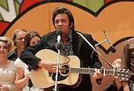 June 1972, Dallas, Texas, USA <br /> Johnny Cash performing at &quot;Explo 72&quot;  with June Carter and her family. The Explo 1972 was an evangelical conference and festival that took place in Dallas, Texas, from June 12 to June 17. The event was sponsored by the Campus Crusade for Christ and organized by Paul Eshleman. A crowd of 80,000 mostly young people from over 75 countries congregated to praise Jesus. An even larger crowd of 180,000 came to the nine hour rock festival that closed the festivities.
