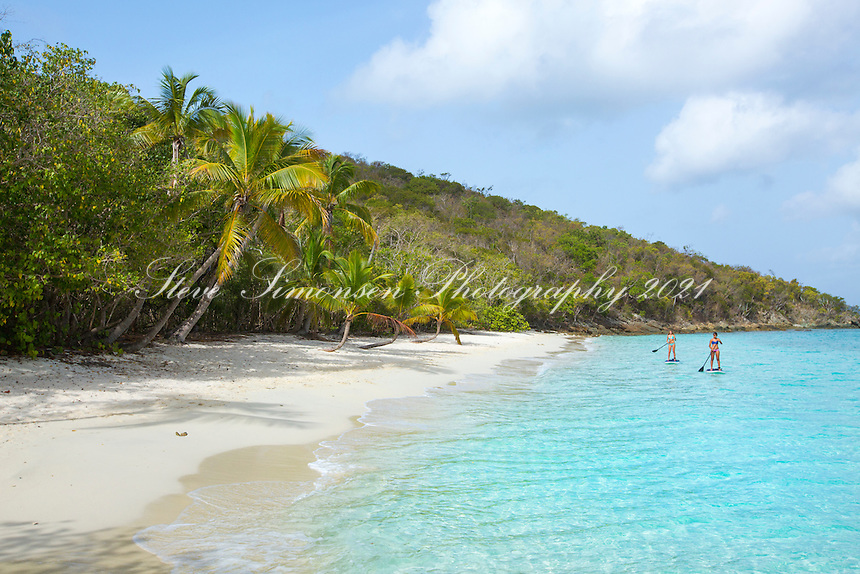 Stand up paddle boarders<br /> Salomon Beach<br /> Virgin Islands National Park<br /> St. John<br /> US Virgin Islands