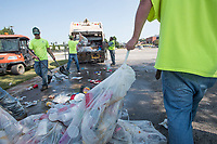 NWA Democrat-Gazette/J.T. WAMPLER A crew from the University of Arkansas' facilities management pack a truck with garbage Sunday Sept. 10, 2017 while cleaning up after the home football game on Saturday. The crew of six men picked up 8 to 10 tons of garbage just from the tailgating areas of campus. They started at 7:00 A.M. and had two trucks loaded with the trash by 11:00 A.M., moving over a ton of garbage each.